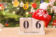 Free Date 6 December With Cap And Festive Tree With Decoration In Background, Christmas Time Concept Royalty Free Stock Image - 104371006