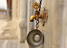 Date of ablution tap made ​​of brass Royalty Free Stock Photography