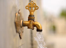 Date of ablution tap made ​​of brass Stock Images