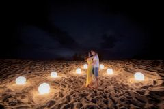 Date, beach, candle Royalty Free Stock Images