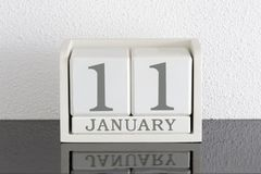 Date blanche 11 de présent de calendrier de bloc et mois janvier Photographie stock