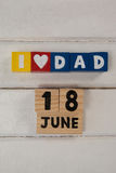 Date and blocks arranged on wooden plank Royalty Free Stock Photos