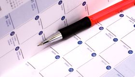 Date Book. Personal pocket calendar with mechanical pencil Stock Photography