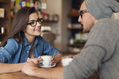 Date at cafe. Loving couple on date at cafe Royalty Free Stock Photography