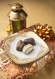 Date chocolates. Date-chocolate and a traditional lamp - a Ramadan display royalty free stock photos