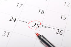 Date circled on a calendar. With pen.Christmas Stock Images