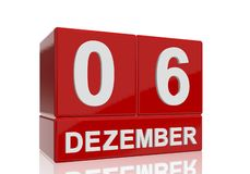The date of 6 Dezember in white numbers and letters on red, glossy blocks. Standing and mirrored isolated in front of a white background stock illustration