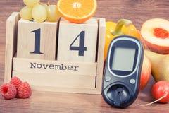 Date du 14 novembre, du glucometer et des fruits avec des légumes, concept de jour de diabète du monde Photos stock