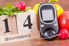 Date du 14 novembre, du glucometer et des légumes, concept de jour de diabète du monde Photographie stock libre de droits