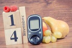 Date du 14 novembre, du mètre de glucose et des fruits, concept de jour de diabète du monde Image libre de droits