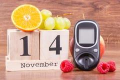 Date du 14 novembre, du mètre de glucose et des fruits mûrs, concept de jour de diabète du monde Photographie stock