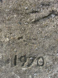 Date 1970 embedded in gray stone with pebbles Royalty Free Stock Images
