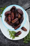 Date exotic fruit. On a plate in a rustic style stock photos