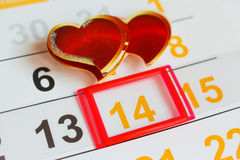 Date February 14 marked on the calendar. Two hearts the concept of love Stock Photography