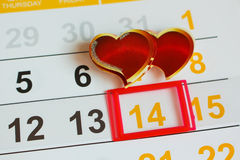 Date February 14 marked on the calendar. Two hearts the concept of love Stock Images