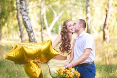 Date in the forest. A man kisses a woman on the bike on a bicycle stock photography