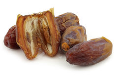 Date fruit and a cut one Royalty Free Stock Photo