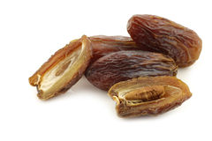 Date fruit and an opened one Stock Photo