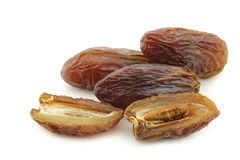Date fruit and an opened one Stock Images