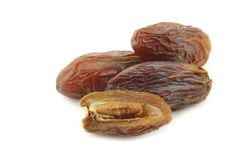 Date fruit and an opened one Royalty Free Stock Photo