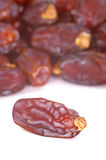 Date Fruits. Close up shot of date fruits on white background Royalty Free Stock Photography