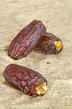Date Fruits. Close up shot of date fruits on desert sand Stock Photos