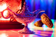 Date fruits Aladdin's lamp and arabic lantern. Date fruits,Aladdin's lamp and arabic lantern. Ramadan Eid background concept Stock Image