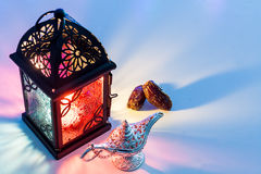 Date fruits Aladdin's lamp and arabic lantern. Date fruits,Aladdin's lamp and arabic lantern. Ramadan Eid background concept Royalty Free Stock Images