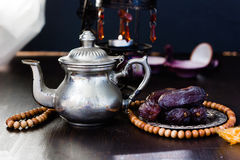 Date fruits on metal plate in ramadan month for iftar opening. Royalty Free Stock Photos