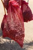 Date fruits ripen in a red sack stock photos