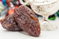 Date fruits and silver alaadins lamp. Date fruits and silver alaadin's lamp. Ramadan Eid concept Royalty Free Stock Images