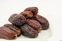Date fruits in white plate Royalty Free Stock Images