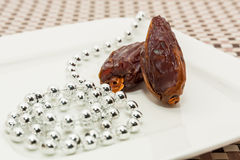 Date fruits in white plate Royalty Free Stock Photo