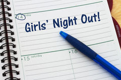 A Date for Girls Night Out. A day planner with blue pen with text Girls Night Out Royalty Free Stock Images