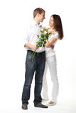 Date: guy presenting flowers to young lady Royalty Free Stock Images