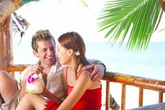 Date in hut. A portrait of attractive couple having fun on the beach Stock Photo