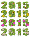 Date 2015 lined with green leaves with drops of dew, red berries. And flowers.Collage of 4 labels on a white background Stock Images