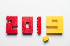 Date 2019 made with toy building blocks. Date 2019 made with red and yellow toy building blocks on white background stock photography