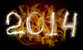 Date New Year 2014. Of photo sparkle Bengal light on background with flame, collage of figure Stock Image