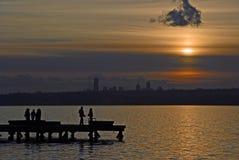 Date Night. People hanging out on a pier on Lake Washington in Kirkland, WA Stock Photos