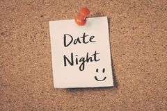Date Night. Reminder message on a cork board Royalty Free Stock Photography