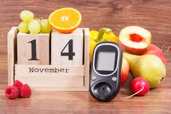 Date 14 November as symbol of world diabetes day, glucometer for measuring sugar level and fruits with vegetables Stock Images
