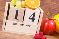 Date of 14 November on calendar and fruits with vegetables, world diabetes day concept Stock Images
