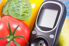 Date of 14 November, glucometer and fresh vegetables, world diabetes day concept royalty free stock photo
