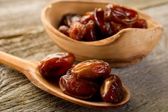 Date over wood spoon Royalty Free Stock Photo