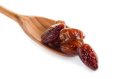 Date over wood spoon Stock Photos