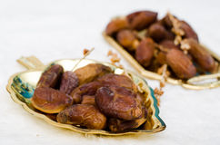 Date palm. Dates fruit on golden tray Stock Photography