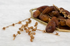 Date palm. Dates fruit on golden tray Stock Image