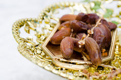 Date palm. Dates fruit on golden tray Royalty Free Stock Photography