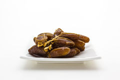 Date palm fruit in the plate Stock Photos